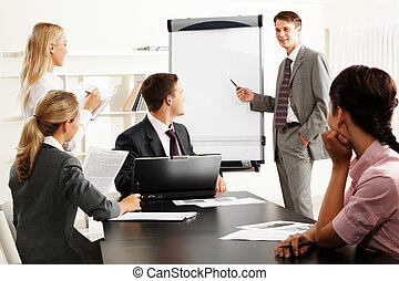 Presenting ideas - Image of smart business people looking at...