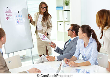 Presenting strategy - Confident businesswoman explaining...