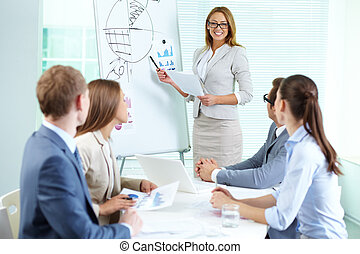Presenting strategy - Confident businesswoman explaining ...