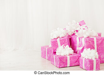 presents gift boxes stack, birthday in pink color for female...