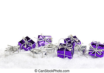 presents - lPresents purple and silver on artificial snow ...