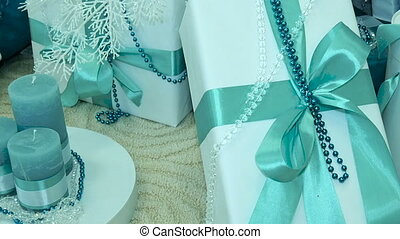 Presents under decorated Christmas tree. close-up