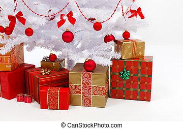Presents under white christmas tree