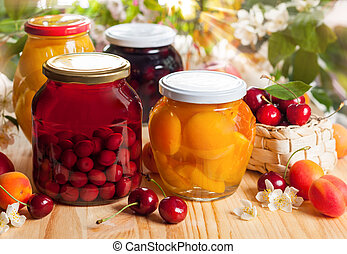 Preserved fruit and berries - Jars of homemade fruit...