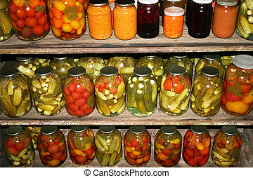 Preserved - Homemade preserves sitting on to shelf in...