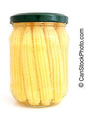 Preserved mini corn ears in glass jar