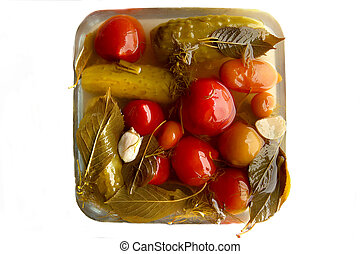 Preserved vegetables tomato and cucumber isolated on white background.