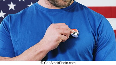 Man putting on Vote sticker for Presidential election 2020 in America.
