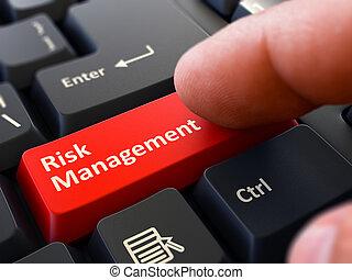 Press Button Risk Management on Black Keyboard.
