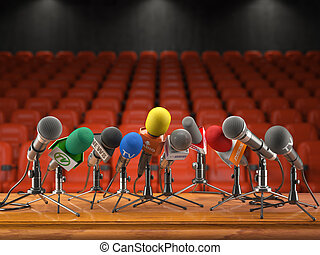 Press conference or interview event concept. Microphones  of different mass media, radio, tv in conference hall with red seating for spectators