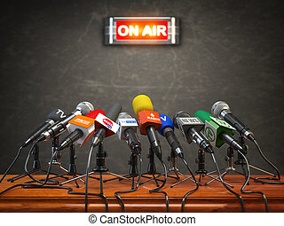 Press conference or interview on air. Microphones of different mass media, radio, tv and press prepared for conference meeting.
