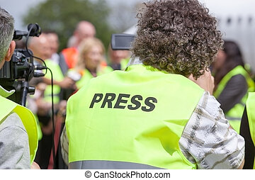 Press - Covering an media event with a video camera