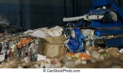 Press machine presses household waste or garbage in Russia -...