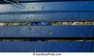 Press machine presses household waste or rubbish - Recycling...