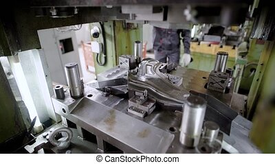 press production. Machine parts are produced using a sheet steel mold.