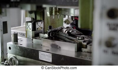 press production. Machine parts are produced using a sheet steel mold. Vehicle suspension part