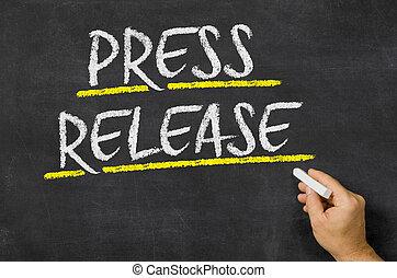 Press Release written on a blackboard