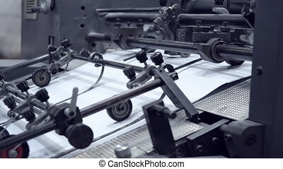 press typography apparatus - pan on printing machine...
