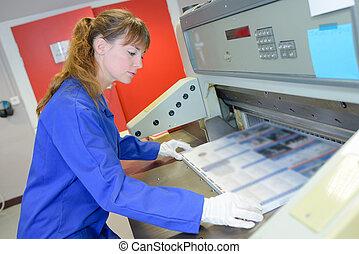 press worker and machine