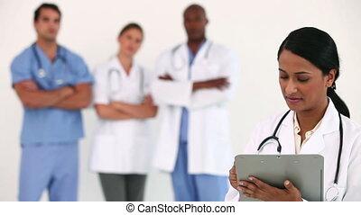presse-papiers, docteur, écriture