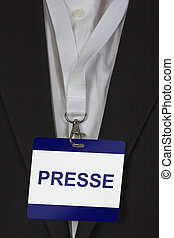 """Presse Pass - man in suite wearing a pass labeled """"Presse"""" (..."""