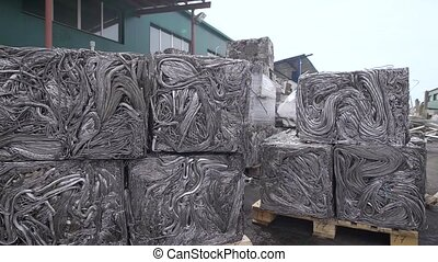 Pressed metal pipes for recycling, sorted garbage is...