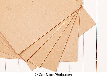 Pressed paper on wooden background