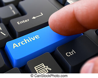 Pressing Blue Button Archive on Black Keyboard.