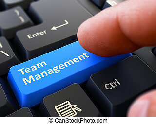 Pressing Blue Button Team Management on Black Keyboard.