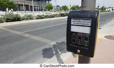 Pressing crossing signal button at intersection