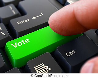 Pressing Green Button Vote on Black Keyboard.