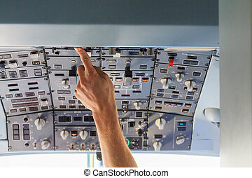 Pressing overhead cockpit buttons