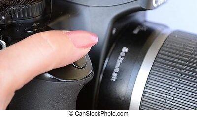 Pressing Photo Camera Trigger - A woman photographer...