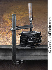 pressing stack of hard drives with a clamp