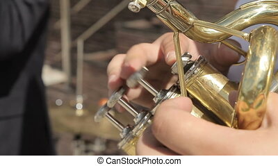 Pressing the buttons on the wind instrument