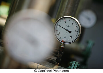 Pressure gauge against sunny background