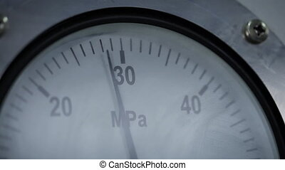 Pressure gauge in a factory, arrow movement on an industrial pressure gauge. Industrial pressure gauge