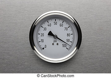 Pressure gauge shot on stainless steel background