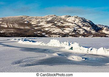 Pressure ridge on frozen Lake Laberge Yukon Canada