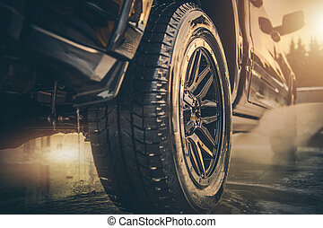 Pressure Washing Pickup Truck in a Car Wash