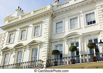 Decorated entrances of large houses in London's wealthy neighborhood Notting Hill.