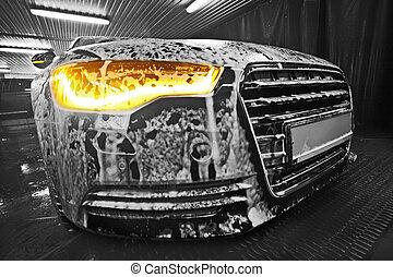 car in foam on sink - prestigious new black car in foam on...