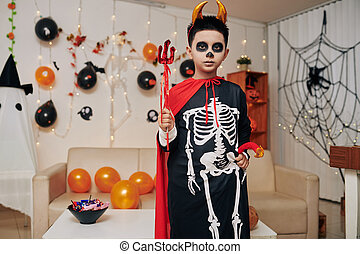 Preteen boy at Halloween party