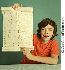 preteen boy hold lavash thin pita bread roll