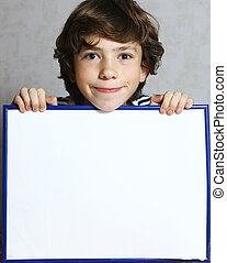 preteen boy with blank sheet paper in frame