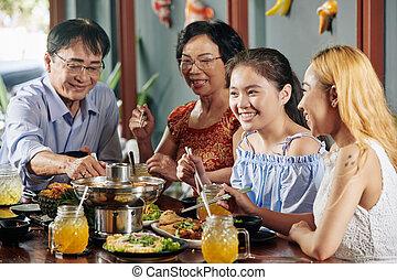 Preteen girl at family dinner
