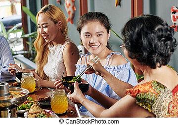 Preteen girl enjoying family dinner
