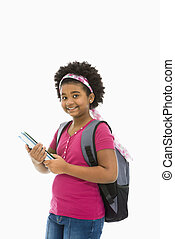 Preteen girl. - African American girl holding books and...