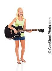 preteen girl playing a guitar - cheerful preteen girl...