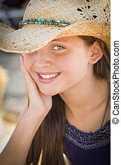 Preteen Girl Portrait Wearing Cowboy Hat in Rustic Setting.